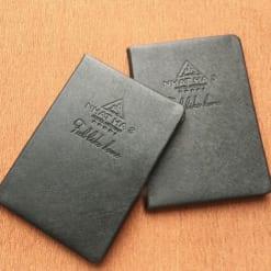 SDG-05-So-tay-bia-da-dan-gay-dap-logo-NHAT-HA-3-xuong-san-xuat-so-da-may-chi-in-logo-gia-re-lam-qua-tang-khach-hang-quang-cao-1 (1)